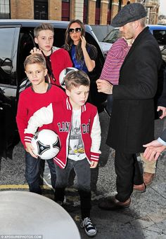 The Beckhams: David appeared to be doing a head count as the family exited their car