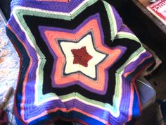 Star shaped baby blanket made with scrap yarn
