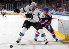 San Jose Sharks defenseman Marc-Edouard Vlasic battles for the puck against Ryan Strome of the New York Islanders (Oct. 16, 2014).