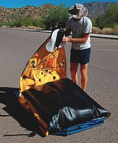 Putting away the Hobie i14t inflatable tandem kayak - fold the stern over everything
