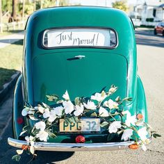 "A chic ceremony exit needs a vintage car, a ""Just Married!"" sign, and lots of pretty flowers for that oh-so perfect photo op #WeddingOfThe Day 