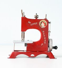 What it is: ..red toy Little Mother sewing machine ..labeled Artcraft Metal Products The good: ..such a bright red color ..in good vintage condition- wheel still has handle and turns ..perfect topper for a stack of old books, or it can certainly stand alone as decor! The