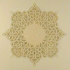 """This is the stencil I used for a ceiling medallion--""""European Lace."""" I stippled on a metallic gold glaze so that it reflects light from below. It's the centerpiece of a tiered ceiling. I'd love to use this stencil again on a small round table top."""