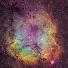 IC 1396 is cataloged as a star cluster with associated nebulosity. In this image, special filters were used to isolate the light of energized sulphur, hydrogen, and oxygen atoms.
