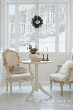 Beautiful antique chairs with snow in the background