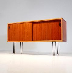Alfred Hendrickx; Walnut and Painted Brass Sideboard for Belform, c1958.