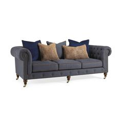 """With a wink and a nod to the iconic Chesterfield sofa, originally fashioned in leather in Victorian England, our button-tufted variation features a fine herringbone fabric cover and contrasting microsuede accents, akin to his favorite Ivy League sport coat - including the cognac suede covered buttons. Perfect for creating that """"lived-in"""" library room, with rich wood turned legs and layers of rugs. You'll want to grab a great book, of course, because once you sit down, we think you won't want…"""