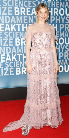 Sienna Miller took the maximalist's approach to romance for a red carpet look that was at once both sweet and unapologetically bold for the 5th Annual Breakthrough Prize Ceremony: a pink floral-print Burberry gown with a sheer ruffled lace overlay.   Shop similar pink dresses: Joanna August, $285; shopbop.com. Free People, $174 (originally $248); nordstrom.com. Needle & Thread, $1,145; net-a-porter.com.