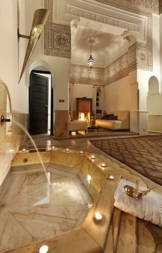 Marble, Hand sculpted ceilings, black Beni Ouarain rugs and gorgeous lighting. Moroccan glam riad.