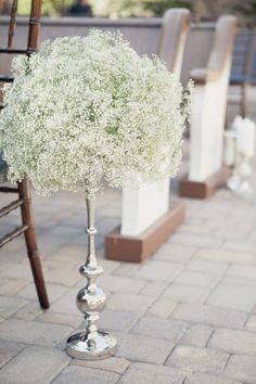 Baby's breath's centerpiece. Light, elegant, not over the top; just enough