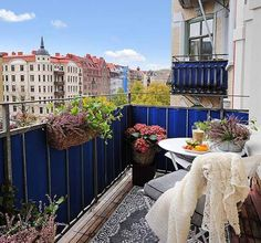 Blue canvas adds some privacy and color to this small balcony