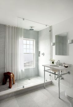 Simple and serene. Clever idea to have a shower curtain as a drape for the window when privacy is needed.