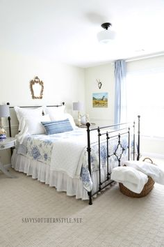 French country style guest room dressed in blue and white