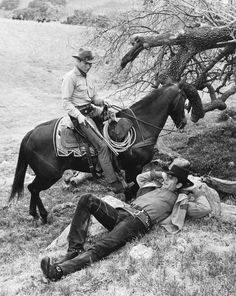Publicity shot for the very first episode of Laramie. When Slim met Jess. SO COOL!!! There's horses & riders in the background!