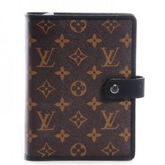This is an authentic LOUIS VUITTON Monogram Macassar Medium Ring Agenda. This classic Louis Vuitton agenda is crafted of traditional Louis Vuitton monogram on toile canvas in a folder style with a cross-over strap and snap that opens to an interior of black cross grain leather with card slots.