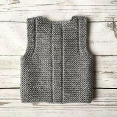 This baby vest is made from of wool, acrylic yarn. It features four buttons for closure The waistcoat is warm, cosily soft and comfortably lightweight. Pictured color: gray Please select desired color and size. Made to order. The baby vest will be Easy Knitting Patterns, Baby Patterns, Knitting Projects, Diy Bebe, Knit Vest, Garter Stitch, Baby Booties, Baby Knitting, Etsy