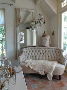 Dress Form and Tufted Sofa with Sheepskin