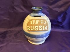 """Vintage Sunrise Pottery Texas Blue & White Salt Glaze """"Trip to Russia"""" Jug Bank. It is signed by pottery and incised mark Sunrise Pottery by LilRedsRetroFinds on Etsy"""