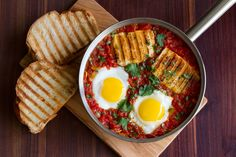Spicy Baked Eggs with Halloumi & Harissa