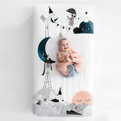 Modern nursery baby crib sheet by Rookie Humans. Unique crib sheet, perfect photo backdrop for newborn baby pictures. Black and white with pops of navy & blush. Gender neutral design for boy & girl nurser