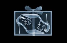 "X ray Art by Nick Veasey Jimmy Choo. Nick says: ""The nails make me laugh. Typical fashion – all top show. The shoes look fantastic, but when you see how they are put together you wonder about the sacrifices women make for fashion. X Ray Christmas Tree, Merry Christmas, Christmas Gifts, Christmas Decorations, Big Gift Boxes, Art Nouveau, Dior, Inside Shoes, Chanel"
