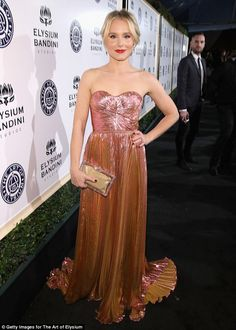 Glamorous:Veronica Mars star Kristen Bell, 36, opted for elegance in a strapless, shimmer...