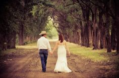 husband and wife wedding pic down an old dirt road