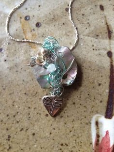 Abalone shell necklace with dragonfly charm by MarquisCreations Ü