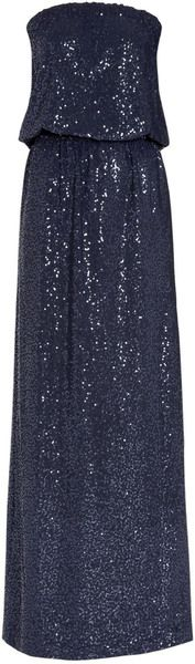 Navy blue sequin embellished jersey bandeau maxi dress with an elasticated waist and a slit to the back. Model is a standard UK 8 and is wearing a size XS