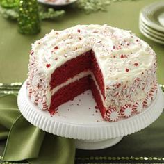 Peppermint Red Velvet Cake - butter - sugar - 2 eggs - sour cream - white vinegar - cake flour - baking cocoa - buttermilk - cream cheese - peppermint extract - powdered sugar - crushed peppermint candies - whole peppermint candies