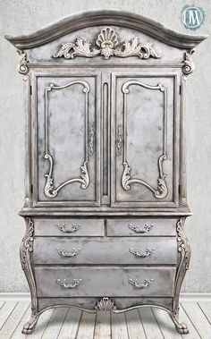 Stunning wardrobe transformed by Annei Sloan Stockist Rachelle Fleming of Originally Worn in Macon, MO | Chalk Paint® by Annie Sloan in layers of Graphite, Paris Grey, Old Ochre and Pure White. She also added a touch of Annie Sloan Gilding Wax and finished with Clear and Black Chalk Paint® Wax. What a beauty!
