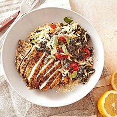 This Greek-flavored chicken dinner is a touch over 400 calories, but it includes your veggies and pasta -- making it a complete dinner. Lemon peel and juice punch up flavor without adding sodium or fat.