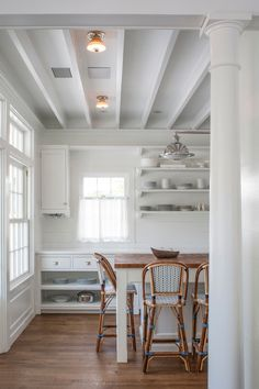 cottage kitchen w/tongue & groove backsplash & open shelving; butcher block island