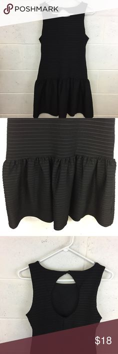 """Bisou Bisou Black peplum skirt dress keyhole back Beautiful size 8 Bisou Bisou dress. Keyhole Detail on back with peplum style skirt. Robbed black material with good stretch.  L:34""""  Bust: 34""""  Hips: 36""""  Waist 30""""  All items from smoke and pet free home.  Flaws and defects, if present, will be noted in photos and description.  Questions welcome and thanks for looking! Bisou Bisou Dresses Mini"""