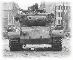 A late war, US Pershing Tank moving through a small German town. M26 Pershing, Military Photos, Military History, Military Armor, Military Tank, Patton Tank, Us Armor, Sherman Tank, Tank Destroyer