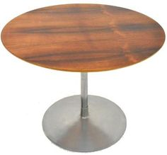"""Beautiful coffe / side table model """"circus"""" byPierre Paulin for dating from the 60s. Round tabletop made of walnut, aluminum base. Good vintage condition."""