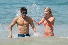 Ciara splashing Andrew