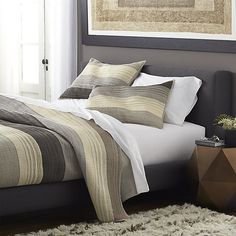 """Warm greys sweep in horizontal bands, accented with hand-guided embroidery. Polyester topside brings out the sheen, reversing to soft cotton. Linens have neat self-hemmed edges. Shams have generous overlapping closures on the back. <A HREF=""""/spill.aspx?c=1691"""">Bed pillows</A> also available.<br /><br /><NEWTAG/><ul><li>100% polyester front</li><li>100% cotton back</li><li>100% rayon embroidery</li><li>Machine wash cold; tumble dry low</li><li>Do not bleach or iron</li><li>Shams have overlap…"""