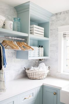 Laundry Room Organization // Blue and White Laundry Room