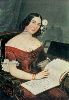 Verdi's mistress Giuseppina Strepponi, with whom he saw Dumas play in Paris in early 1852. The painting is by an anonymous artists and is kept in the Museo Teatrale (Scala) of Milan. Strepponi holds the score of Verdi's Nabucco in her hands.