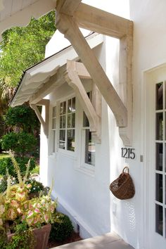 TRIM DETAIL – spanish style bungalow in old cloverdale historic home by ashley gilbreath interiors. Spanish Bungalow, Spanish Style Homes, Spanish House, Living Room Playroom, Door Overhang, Window Awnings, Awning Roof, Marquise, House Front