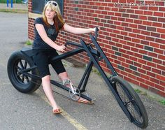 Chopper bike made with square steel tubing and a car wheel. Note the length of the chain.