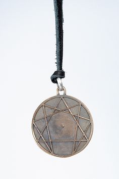 RIMA HYENA LARGE GNOSTIC CIRCLE   Rima Hyena large Gnostic Circle (combination of the zodiac) alchemy charm. Silver/bronze mixture hand cast. Photographed on leather.
