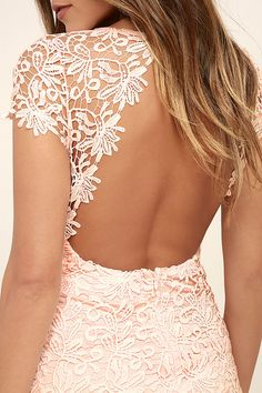 We admire any girl who can put together a great outfit, but honestly, the Hidden Talent Backless Blush Lace Dress makes it easy! This beautiful bodycon dress has sheer cap sleeves and a backless design (with top button). Hidden back zipper/hook clasp.