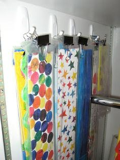 Use binder clips and hooks to store extra bulletin board borders!  Fabulous idea!