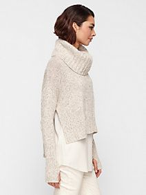 Warm layers, cropped and boxy turtle neck sweater with deep side slits and extra long, slim sleeves. Worn over a loose, silky tunic and pale skinny jeans. Perfection. How could you go wrong in an outfit like this?