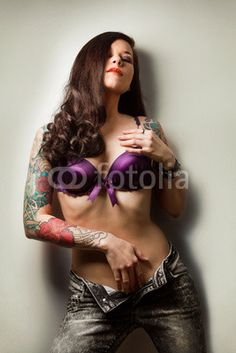 Beautiful Girl With Stylish Make-up And Tattooed Arms - not everything we sell is G Rated.  Liven our walls with some art!