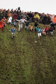Cooper's Hill Cheese Rolling Festival in Brockworth, England. A 7 pound circle of Double Gloucester is dropped down the hill and the lads try to outrun it.