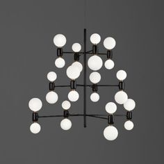 ABALLS CHANDELIER 12: Suspension lamp. Structure in glossy lacquered white, black or golden electroplated steel. Ceramic bases in same colours. Diffuser in blown opal matt glass.