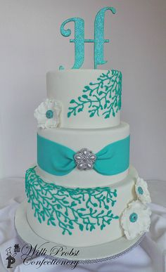 Turquoise & silver three tier wedding cake